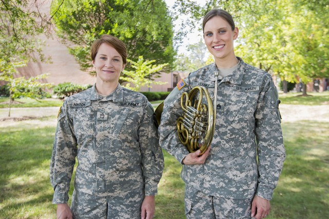 "Master Sgt. Leigh Ann Hinton and Staff Sgt. Christy Klenke, of the the U.S. Army Band ""Pershing's Own,"" began a music therapy outreach program to help fellow service members cope with mental and physical challenges."