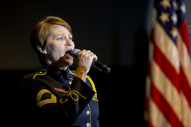 "Master Sgt. Leigh Ann Hinton, of the U.S. Army Band ""Pershing's Own,"" sings ""The Star-Spangled Banner"" on Joint Base Myer-Henderson Hall, Sept. 1, 2015. She is the co-founder of a music therapy outreach program, which helps fellow service members cope with mental and physical challenges."