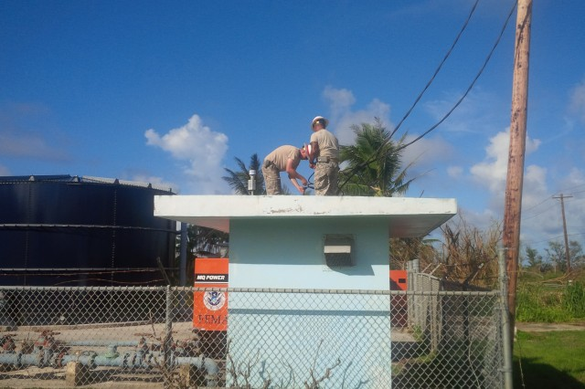 Soldiers, from the U.S. Army's 249th Engineer Battalion Delta Company, U.S. Army Corps of Engineers, connect emergency generator power lines to a water pump substation on Saipan as part of the federal response to Typhoon Soudelor.