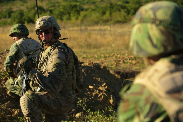 Sgt. 1st Class Daniel Deen, a platoon sergeant assigned to 1st Battalion, 503rd Infantry Regiment, 173rd Airborne Brigade out of Vicenza, Italy, conducts squad maneuvers during a live-fire exercise at Novo Selo Training Area, Bulgaria, Sept. 1, 2015. The 'Sky Soldiers' from the 173rd Airborne are currently deployed to Bulgaria as part of Operation Atlantic Resolve, an ongoing, multinational partnership focused on combined-training and security cooperation between the U.S. and other NATO allies. (Photo by U.S. Army Staff Sgt. Brooks Fletcher, 16th Mobile Public Affairs Detachment)