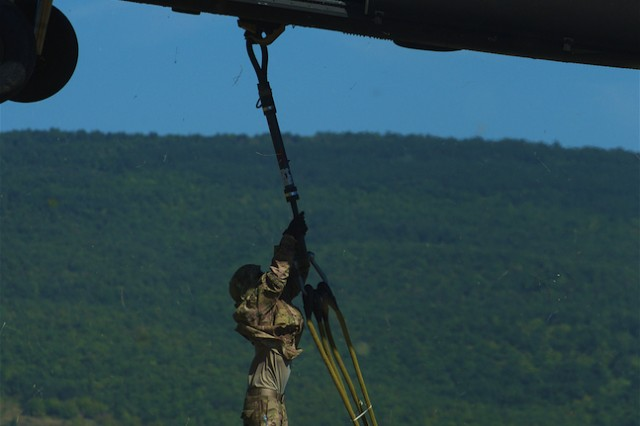 Artillerymen assigned to 4th Battalion, 319th Airborne Field Artillery Regiment, 173rd Airborne Brigade out of Grafenwöhr, Germany, sling load an M119 Howitzer to a UH-60 Blackhawk from the 4th Battalion, 3rd Combat Aviation Brigade, 3rd Infantry Division out of  Hunter Army Airfield; Ga., during a live-fire exercise at Novo Selo Training Area, Bulgaria, Sept. 1, 2015. Soldiers from the 173rd Airborne and 3rd CAB are currently deployed to Bulgaria as part of Operation Atlantic Resolve, an ongoing, multinational partnership focused on combined-training and security cooperation between the U.S. and other NATO allies. (Photo by U.S. Army Staff Sgt. Brooks Fletcher, 16th Mobile Public Affairs Detachment)
