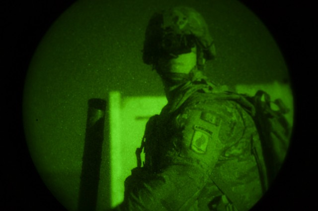 Pfc. Isaac Bautista, a mortar man assigned to 1st Battalion, 503rd Airborne Infantry Regiment, 173rd Brigade out of Vicenza, Italy, looks through his night vision googles during a live-fire exercise at Novo Selo Training Area, Bulgaria, Sept. 1, 2015. Bautista, along with other Soldiers from, 173rd Airborne Brigade are currently deployed to Bulgaria as part of Operation Atlantic Resolve, an ongoing, multinational partnership focused on combined-training and security cooperation between the U.S. and other NATO allies. (Photo by U.S. Army Staff Sgt. Brooks Fletcher, 16th Mobile Public Affairs Detachment)