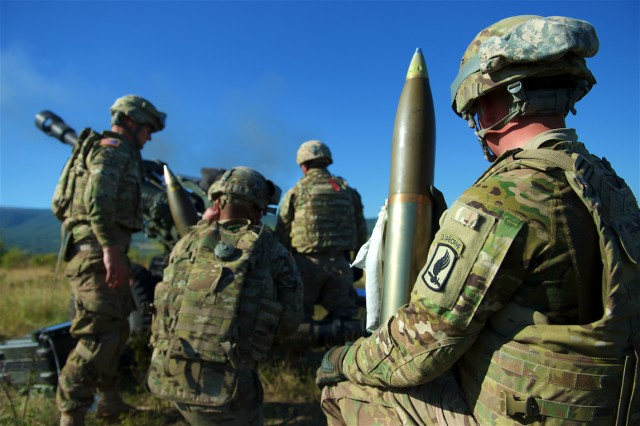 U.S. Army Artillerymen assigned to 4th Battalion, 319th Airborne Field Artillery Regiment, 173rd Airborne Brigade out of Grafenwöhr, Germany, wait to load 105mm high explosive ammunition into a M119 Howitzer during a live-fire exercise at Novo Selo Training Area, Bulgaria, Sept. 1, 2015. The 'Sky Soldiers' from the 173rd Airborne are currently deployed to Bulgaria as part of Operation Atlantic Resolve, an ongoing, multinational partnership focused on combined-training and security cooperation between the U.S. and other NATO allies. (Photo by U.S. Army Staff Sgt. Brooks Fletcher, 16th Mobile Public Affairs Detachment)