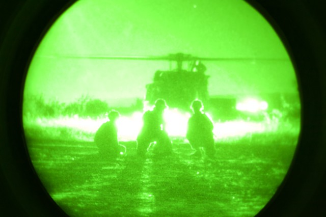 A U.S. Army UH-60 Blackhawk from the 4th Battalion, 3rd Combat Aviation Brigade, 3rd Infantry Division out of  Hunter Army Airfield; Ga., picks up U.S. Army paratroopers assigned to 4th Battalion, 319th Airborne Field Artillery Regiment, 173rd Airborne Brigade out of Grafenwöhr, Germany, during a night  live-fire exercise at Novo Selo Training Area, Bulgaria, Sept. 1, 2015. Soldiers from the 173rd Airborne and 3rd CAB are currently deployed to Bulgaria as part of Operation Atlantic Resolve, an ongoing, multinational partnership focused on combined-training and security cooperation between the U.S. and other NATO allies. (Photo by U.S. Army Staff Sgt. Brooks Fletcher, 16th Mobile Public Affairs Detachment)
