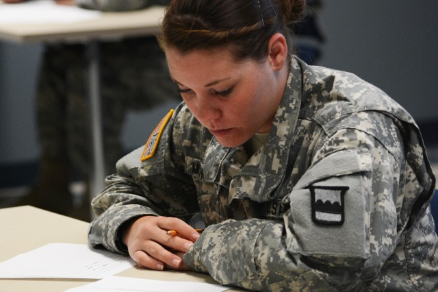CAMP BULLIS, Texas -- Spc. Kristina McPherson, a competitor from the 3/379th Logistics Support Battalion takes the transportation and maintenance written exam during day three of the 2015 80th Training Command (TASS) 'Truck Rodeo' competition. The three-day competition hosted by the 800th Logistic Support Brigade, which started on Sept. 1, assesses the competence level of truck drivers and wheeled vehicle mechanics within the 80th Training Command (TASS).
