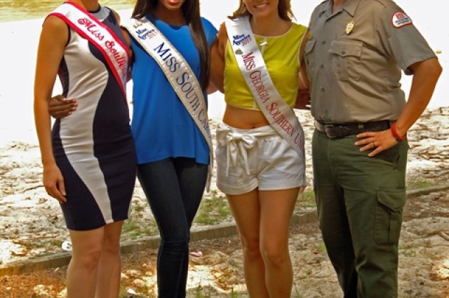 From left to right: Miss Southeast Catherine Fox, Miss South Carolina Daja Dial, Miss Georgia Southern University Megan Johnson and Corps Park Ranger Ron Woodall, gather before Thurmond Lake to remind boaters of all ages to wear their life jackets.