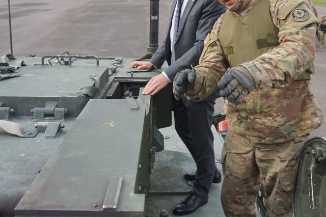 U.S. Army Sgt. Ramiro Rodriguez, with 4th Squadron, 2nd Cavalry Regiment, explains the capabilities of the Stryker vehicle to the U.S. Ambassador to Czech Republic Andrew H. Schapiro during the eve of the Dragoon Crossing at Ruzyne Military Barracks Sept. 9, 2015. (U.S. Army photo by 1st Lt. Katie Essex, Military Intelligence officer, 4th Squadron, 2nd Cavalry Regiment)