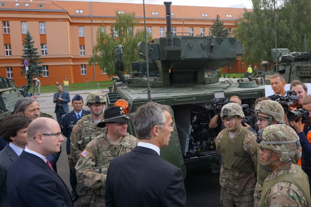 Jens Stoltenberg, secretary general for the North Atlantic Treaty Organization, talks with Soldiers on the eve of the Dragoon Crossing from 4th Squadron, 2nd Cavalry Regiment during a static display at Ruzyne Military Barracks Sept. 9, 2015. Dragoon Crossing is intended to improve combined operational capability and ensure the continued peace and stability of Europe. (U.S. Army photo by Maj. Andrew Ruiz, Engagements Chief for 4th Infantry Division, Mission Command Element)