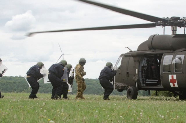 German Bundeswehr Soldiers  from 401 Armored Infantry Battalion load into a HH-60 Medevac Black Hawk, for aircraft familiarization and medical evacuation (MEDEVAC) training.  A total of 208 Bundeswehr Soldiers from the battalion, participated in the training supported by 4th Battalion, 3rd Aviation Regiment, Sept. 8-9, at the Hammelburg Training Area, Germany.