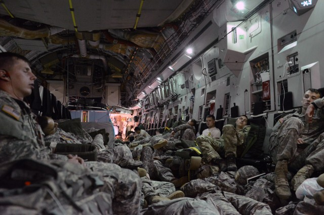 Soldiers, from the 509th Parachute Infantry Regiment, are shown during a 19-hour flight from Alaska to Australia trying to get some sleep on the floor and seats of a Royal Australian Air Force C-17 Globemaster, July 8, 2015, during Exercise Talisman Sabre 15. Soldiers, who are deployed, average just three hours of sleep a night, said Lt. Col. Kate E. Van Arman, medical director, Traumatic Brain Injury Clinic on Fort Drum, N.Y..