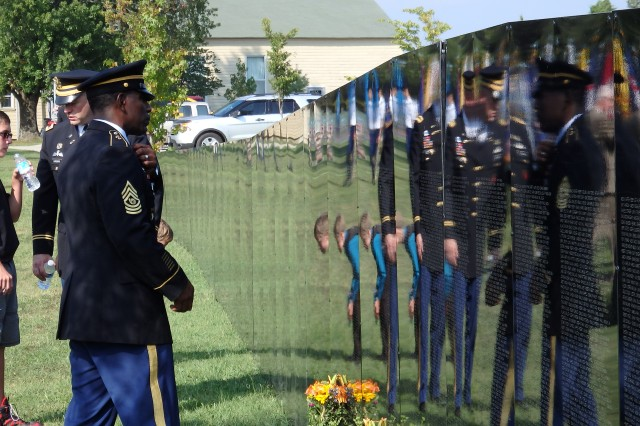 Command Sgt. Maj. Roy Ward, Maneuver Support Center of Excellence and Fort Leonard Wood command sergeant major, pays his respects at the Vietnam Traveling Memorial Wall Sept. 5 at Memorial Grove.