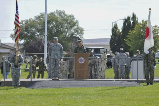 Lt. Col. Dan Rayca, commander of the 4th Battalion, 23nd Infantry Regiment, 2nd Stryker Brigade, 2nd Infantry Division, left, and Col. Shoji Shimomoto, commander of the 33rd Infantry Regiment, 10th Division, Japanese Ground Self-Defense Force, give their opening statements at the Rising Thunder 2015 opening ceremony at the Yakima Training Center in Yakima, Wash., Sept. 8, 2015. Rising Thunder 2015 is the 22nd annual bilateral exercise between the U.S. Army's I Corps elements and the JGSDF. (U.S. Army photo by Sgt. Eliverto V. Larios)