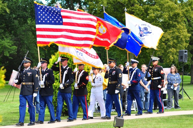 A joint services color guard present the colors at the 9/11 remembrance ceremony at Rock Island Arsenal, Sept. 11. (Photo by Kevin Fleming, ASC Public Affairs)