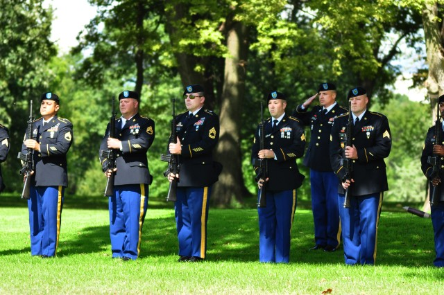 Rock Island Arsenal Soldiers stand at attention after firing a 21-gun salute in honor of the fallen at the 14th anniversary remembrance ceremony of 9/11, Sept. 11. (Photo by Kevin Fleming, ASC Public Affairs)