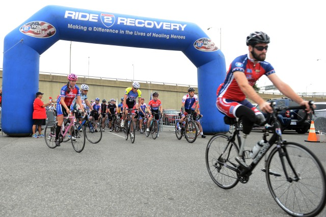 Stefan LeRoy, right, leads the Ride 2 Recovery race at the start. The Ride 2 Recovery bicycle race for wounded veterans and their supporters, began Sept. 12, 2015, at a Pentagon parking lot and wound through Arlington and Alexandria neighborhoods in an 18- and a separate 45-mile course.