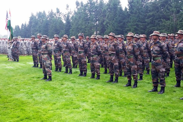 U.S. Soldiers, from the 1st Battalion, 23rd Infantry Regiment, 7th Infantry Division, and Indian army troops, with the 6th Battalion of the Kumaon Regiment, stand together during the opening ceremony of Yudh Abhyas 15 at Joint Base Lewis-McChord, Wash., Sept. 9, 2015.