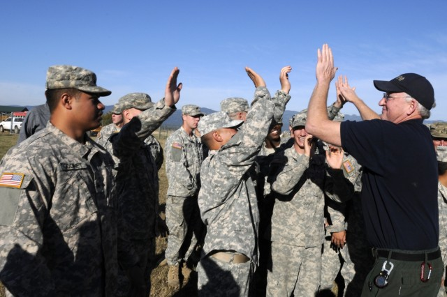Tom Kruth, right, chief of wildland fire and aviation, Alaskan Division of Forestry, high fives Soldiers assigned to Task Force First Round, out of Joint Base Lewis McChord, Wash., following a recognition ceremony at the Kalispel Indian Resevation, Washington, Sept. 13, 2015. Kruth, who oversaw all wildland firefighting operations the Soldiers were assigned to, thanked the Soldiers for their support and said their it will always be welcome in the future.