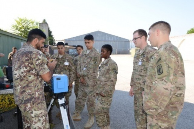 Italian soldiers from the 7th NBC Defense Regiment brief U.S. paratrooper from the 173rd Airborne Brigade on their equipment capabilities during combined Exercise Toxic Dragon in Rieti, Italy, Aug. 31.