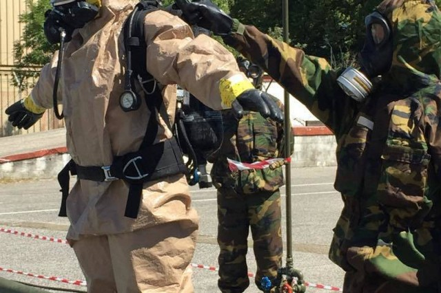 U.S. and Italian soldiers practice decontamination techniques during combined Exercise Toxic Dragon in Rieti, Italy, Aug. 31.