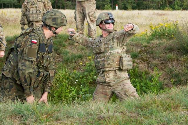Spc. Jace Leeth, a Soldier P Troop, 4th Squadron, 2nd Cavalry Regiment, throws a Polish practice grenade Sept. 15, 2015, at the Drawsko Pomorskie Training Area in Poland. The U.S. Soldiers are in Poland as part of Operation Atlantic Resolve, an ongoing multinational partnership focused on combined training and security cooperation between NATO allies. Led by the mission command element of the 4th Infantry Division and in conjunction with European partner nations, Atlantic Resolve is intended to improve combined operational capability in a range of missions and ensure the continued peace and stability of Europe. (U.S. Army photo by Spc. Marcus Floyd, 7th Mobile Public Affairs Detachment)