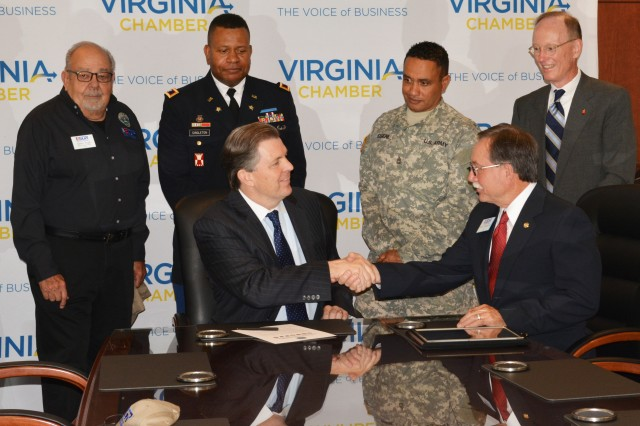 (Left) Barry DuVal, president and CEO of the Virginia Chamber of Commerce shake hands with Steve Villalpando, the Employer Support for National Guardsmen and Reserve Soldiers Chair, Virginia Committee, after DuVall signed a statement of support for Virginia National Guardsmen and Reserve Soldiers, Richmond, Va., Sept. 14, 2015. The Statement of Support Program is the cornerstone of the Employer Support Guard and Reserve's effort to gain and maintain employer support for the Guard and Reserve. The intent of the program is to increase employer support by encouraging employers to act as advocates for employee participation in the military. Supportive employers are critical to maintaining the strength and readiness of the nation's Guard and Reserve units. (Rear left-right) Omar Pugh, ESGR military outreach director, Va., Col. Terrance Singleton, 94th Training Division, Fort Lee Va., Sgt. 1st Class Phillip Eugene, Headquarters Company, 80th Training Command (TASS) and James W. Hopper General Counsel Virginia Association of Realtors.