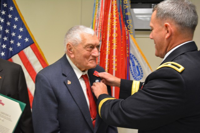 Brig. Gen. Steven Ainsworth, commander 94th Training Division, awards the Bronze Star medal to WWII veteran Technician 4th Class, retired, Vincenzo Geramita during an intimate ceremony filled with family, friends and service members at Fort Dix, N.J., Sept. 12, 2015. Geramita and Lt. Col., retired, Andrew Cella each received the medal after 70 years because after they earned their Combat Infantry Badges for the fighting they experienced in Europe, neither one knew that a 1947 general order made them eligible for the Bronze Star since they had earned their CIBs between 1941 and 1945.