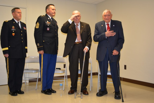 (From left) Brig. Gen. Steven Ainsworth, commander of the 94th Training Division, Command Sgt. Maj. Arlindo Almeida, senior noncommissioned officer 94th TD, and WWII veterans Andrew Cella and Vincenzo Geramita. Ainsworth awarded Cella and Geramita their well-deserved Bronze Star medals, after 70 years, during an intimate ceremony filled with family, friends and service members at Fort Dix, N.J., Sept. 12, 2015.