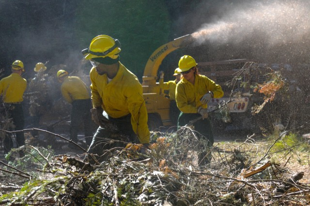 Soldiers from Task Force First Round, out of Joint Base Lewis-McChord, conduct cleanup operations to help local and state wild land firefighters with the wildfires in Washington State Sept. 9, 2015. Soldiers have been putting in 10- to 12-hour days in order to complete any task that is given to given to them by the military advisors.