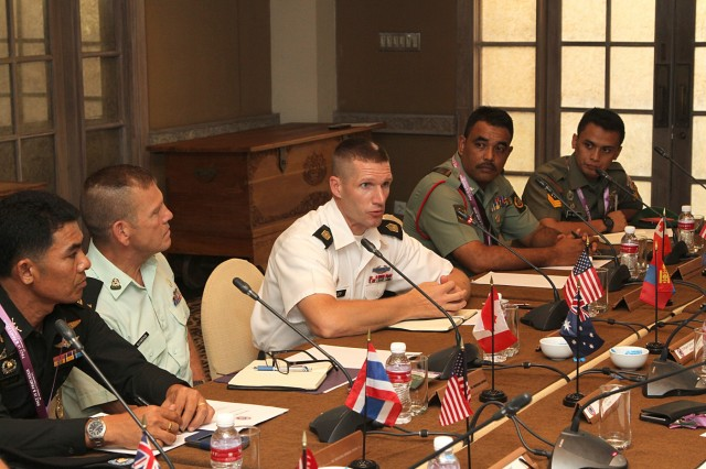 Sgt. Maj. of the U.S. Army Daniel A. Dailey, center, talks with senior enlisted leaders during a forum held at the 9th Pacific Armies Chiefs Conference and Pacific Armies Management Seminar, Sept. 14, 2015.