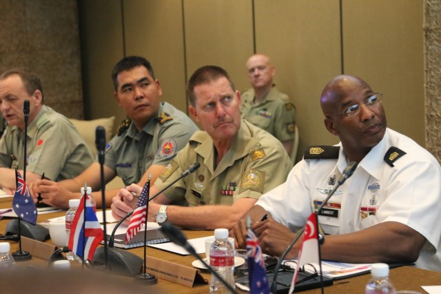 From right, Command Sgt. Maj. Bryant Lambert, U.S. Army Pacific senior enlisted adviser; Warrant Officer Dona Spinks, Australian army sergeant major; and Mongolian Sgt. Maj. of the Army Daribish Oyunbold look at information about peacekeeping operations in the Pacific during a senior enlisted leaders forum held in conjunction with the 9th Pacific Armies Chiefs Conference and Pacific Armies Management Seminar, Sept. 14-15, 2015.