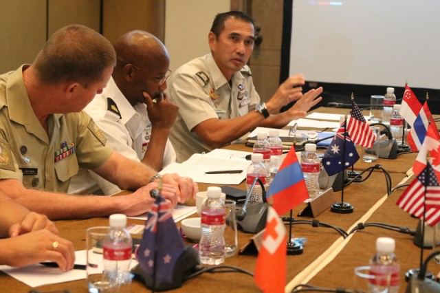 From left, Warrant Officer Dona Spinks, Australian army sergeant major, and Command Sgt. Maj. Bryant Lambert, U.S. Army Pacific senior enlisted adviser, listen to Chief Warrant Officer Ng Siak Ping discuss enlisted matters at the senior enlisted leaders forum held in conjunction with the 9th Pacific Armies Chiefs Conference and Pacific Armies Management Seminar, Sept. 14-15, 2015.