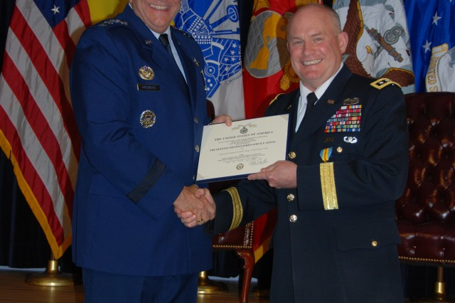 Lt. Gen. David R. Hogg, United States Military Representative to the NATO Military Committee, was presented the Defense Distinguised Service Medal by Gen. Philip M. Breedlove, Supreme Allied Commander, Europe and Commander of U.S. European Command.