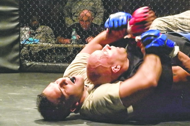 Staff Sgt. Parvin Rosario attempts to apply a submission hold to Sgt. Stephan Rudd during Friday's combatives tournament at Davidson Fitness Center.