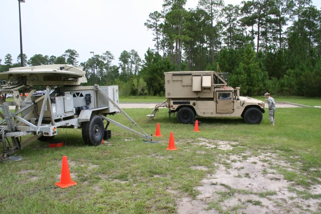 During the Warfighter Information Network-Tactical (WIN-T) Regional Hub Node (RHN) commercial services test event at Fort Stewart in August 2015, the 63rd Expeditionary Signal Battalion used a variety of its organic WIN-T assets to provide satellite transport to and from the RHNs, including this Joint Network Node (right) and Satellite Transportable Terminal (left). (U.S. Army photo by Amy Walker, PEO C3T Public Affairs)
