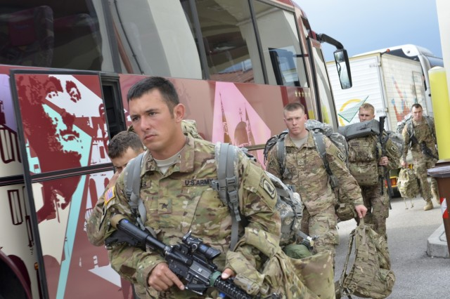 Paratroopers from 1st Battalion, 503rd Infantry Regiment, 173rd Airborne Brigade unload buses during a combined emergency deployment exercise at Aviano Air Base, Italy, Sept. 15.