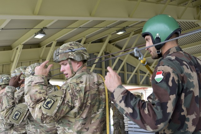 U.S. Army paratroopers from the 173rd Airborne Brigade and Hungarian paratroopers from the 88th Light Mixed Battalion, 25th Infantry Brigade, Hungarian Defense Forces conduct sustained airborne training during a combined emergency deployment exercise at Aviano Air Base, Italy, Sept. 16.