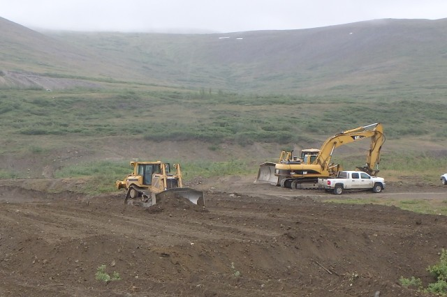 Heavy equipment prepares a landfarming cell near the Tank Site E project near Nome, Alaska. Landfarming is a potential solution to meet the needs of the U.S. Army Corps of Engineers -- Alaska District's Formerly Used Defense Sites program across Alaska. The process includes removing contaminated soil from the source location, spreading it across an expansive area one to two feet thick, tilling consistently and then letting nature take control to degrade the pollutants.
