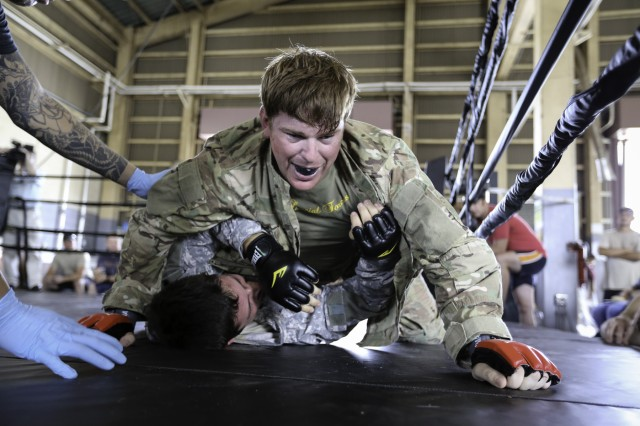 The Soldiers of the 1st Battalion, 1st Special Forces Group are well versed in adapting to the art of war and honed their hand-to-hand combat skills Sept. 3 at Torii Station during Fight Night VI -- a battalion level Modern Army Combatives competition.