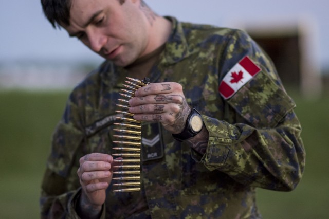 A Canadian soldier counts the rounds on a clip in preparation for a light machine gun night-fire event during the 2015 Canadian Armed Forces Small Arms Concentration at the Connaught Range outside of Ottawa, Canada, Sept. 14, 2015.