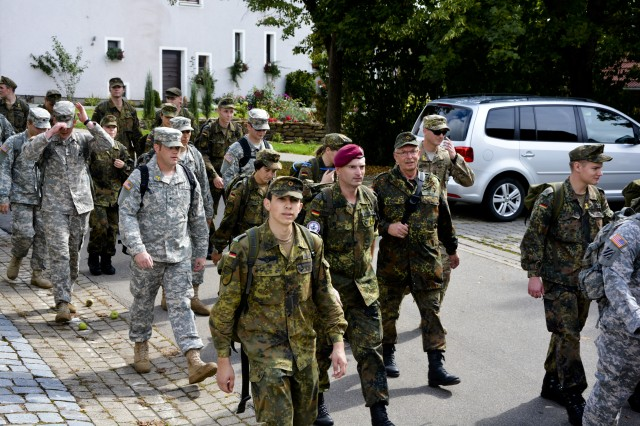 Soldiers from the 12th Combat Aviation Brigade, participated in a solidarity march with the Bundeswher German Armed Forces in Dinklsbühl, Germany, September 14, 2015.  The march is in honor of active duty and up to 2500 deployed German Bundeswher military members, the 12th CAB participated to support the German Armed Forces and to show the partnership with the German public.