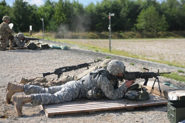 "GRAFENWOEHR, Germany -- Competitors from the 2nd Cavalry Regiment engage targets with the M249 squad automatic weapon during the 2015 European Best Warrior Competition at the Grafenwoehr Training Area Sept. 15. Some 22 candidates participated in the intense, grueling annual weeklong competition, the most prestigious competitive event of the region. In the end, only one junior officer, one NCO and one Soldier emerged as ""Best Warriors."" (Photo by Staff Sgt. Warren W. Wright Jr., 21st TSC Public Affairs)"