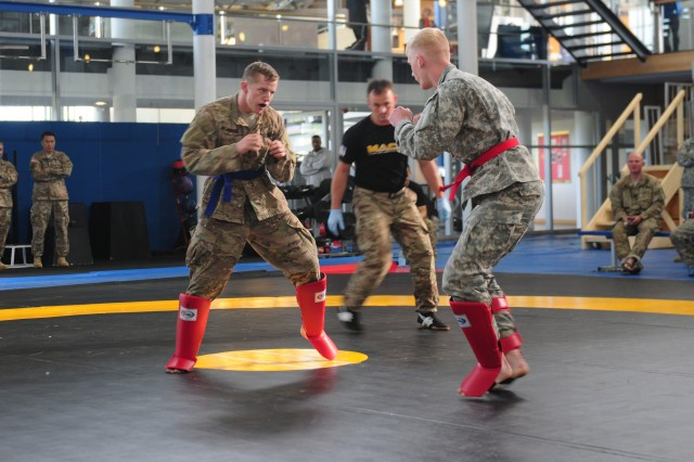 "GRAFENWOEHR, Germany -- The 173rd Airborne Brigade's 1st Lt. Jacob Wijnberg (left), Europe's 2015 ""Best Officer Warrior,"" engages a fellow competitor during the ""combatives"" tournament held Sept. 18 at the Grafenwoehr Physical Fitness Center. Wijnberg, who currently serves in Latvia with Company D, 1st Battalion (Airborne), 503rd Infantry Regiment, triumphed in the junior officer category over five other finalists. The officer BWC culminates at command level. (U.S. Army Photo by Staff Sgt. Warren W. Wright Jr., 21st TSC Public Affairs)"