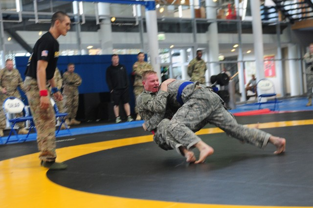 "GRAFENWOEHR, Germany -- Pfc. Christian Schlegel (left), a military policeman, and Staff Sgt. Matthew Collins (right), an intelligence analyst, both with the 21st Theater Sustainment Command, square off during a ""combatives"" tournament conducted as part of the 2015 European Best Warrior Competition Sept. 18 at the Grafenwoehr Physical Fitness Center. Some 22 candidates participated in the intense, grueling annual weeklong competition, the most prestigious competitive event of the region. In the end, only one junior officer, one NCO and one Soldier emerged as ""Best Warriors."" (U.S. Army Photo by Staff Sgt. Warren W. Wright Jr., 21st TSC Public Affairs)"