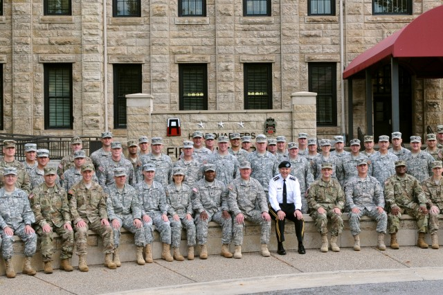 Newly-appointed command team members and Senior Advisors to the Army National Guard join First Army Commanding General, Lt. Gen. Michael S. Tucker, for a group shot during an orientation outside First Army headquarters on Rock Island Arsenal, Ill.
