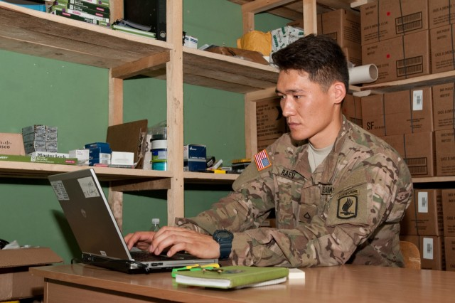 Pvt. Aidarbek Raev, a native of Bishkek, Kyrgyzstan, also a unit supply specialist with Dog Company, 1st Battalion, 503rd Infantry Regiment, 173rd Airborne Brigade, updates unit supply inventory records in Panevezys, Lithuania, Aug. 26, 2015. Raev, Dog Company's sole supply specialist, performs the duties and responsibilities of a Soldier three tiers above his current rank. (U.S. Army photo by Sgt. Jarred Woods, 16th Mobile Public Affairs Detachment)