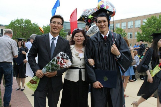 Pvt. Aidarbek Raev, a native of Bishkek, Kyrgyzstan, also a unit supply specialist with Dog Company, 1st Battalion, 503rd Infantry Regiment, 173rd Airborne Brigade, with his mother and older brother at his graduation day at Camden Community College in Blackwood, N.J., May, 2013. Raev is currently serving with Dog Company in Lithuania as part of Atlantic Resolve, a NATO initiative committed to interoperability and building strong allied partnerships throughout the Baltic Region. (Courtesy photo provided by Pvt. Aidarbek Raev, 173rd Airborne Brigade)