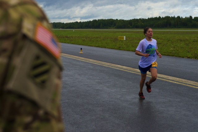 U.S. Army Second Lt. Yarelys Moreau, assigned to the 4th Battalion, 3rd Aviation Regiment, out of Hunter Army Airfield, Ga., finishes in third place during the 10-Mile Shadow Run held on Lielvarde Airfield, Sept. 18. The run, which mirrors the Army Ten-Miler being held Oct. 9-10 in Washington, was conducted to increase camaraderie among U.S. and Latvian forces participating in Operation Atlantic Resolve, an ongoing, multinational partnership focused on combined-training and security cooperation between the U.S. and other NATO allies. (Photo by U.S. Army Staff Sgt. Brooks Fletcher, 16th Mobile Public Affairs Detachment)