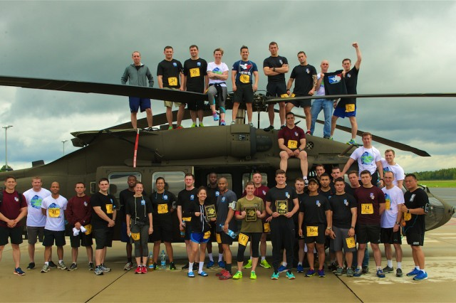 Soldiers assigned to the 1st Battalion, 503rd Infantry Regiment, 173rd Airborne Brigade out of Vicenza, Italy and 4th Battalion, 3rd Aviation Regiment, out of Hunter Army Airfield, Ga., along with airmen from the Latvian Air Force pose in front of a UH-60 Black Hawk following the 10-Mile Shadow Run held on Lielvarde Airfield, Sept. 18. The run, which mirrors the Army Ten-Miler being held Oct. 9-10 in Washington, was conducted to increase camaraderie among U.S. and Latvian forces participating in Operation Atlantic Resolve, an ongoing, multinational partnership focused on combined-training and security cooperation between the U.S. and other NATO allies. (Photo by U.S. Army Staff Sgt. Brooks Fletcher, 16th Mobile Public Affairs Detachment)