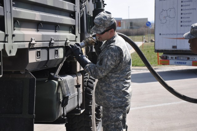 Sgt. John Palmieri, a fueler from Company A, 173rd Brigade Support Battalion, 173rd Airborne Brigade, conducts refueling operations at a stop in Hungary, Sept. 8, during a convoy from Italy to Ukraine, in support of Operation Fearless Guardian.