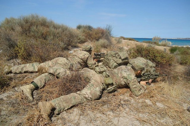 U.S. Army snipers, from the 173rd Airborne Brigade, scout a target during combined Exercise Kepi Blanc with the French Foreign Legion in Calvi, France, Sept. 8, 2015.